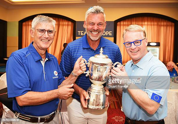 David Williams chairman of the European tour holds the winners trophy with Darren Clarke Captain of team Europe and Keith Pelley CEO of the European...