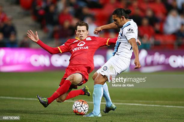 David Williams of Melbourne City competes with Craig Goodwin of Adelaide United during the round five ALeague match between Adelaide United and...
