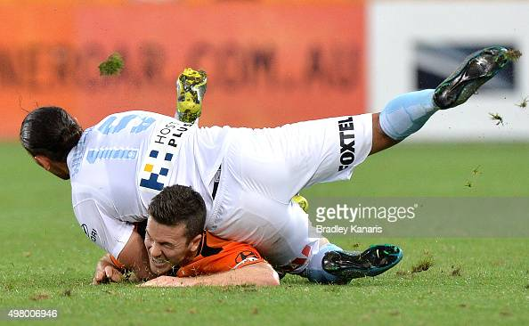 David Williams of Melbourne City lands on top of Matt McKay of the Roar after fouling him in the tackle during the round seven ALeague match between...