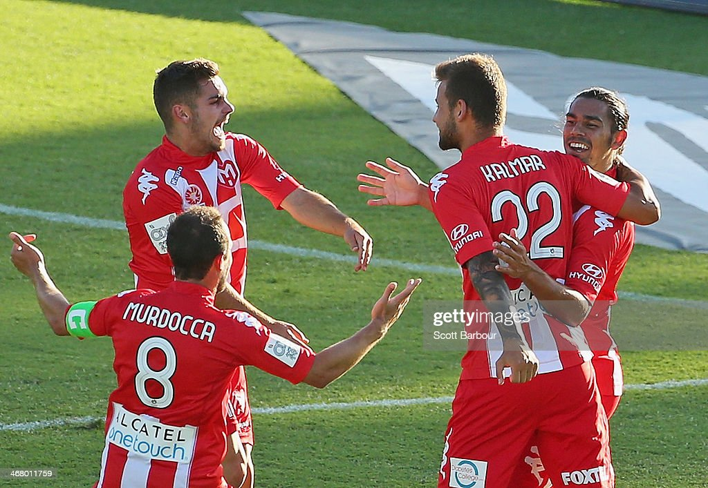 David Williams of the Heart celebrates with his teammates after scoring the winning goal during the round 18 ALeague match between Melbourne Heart...