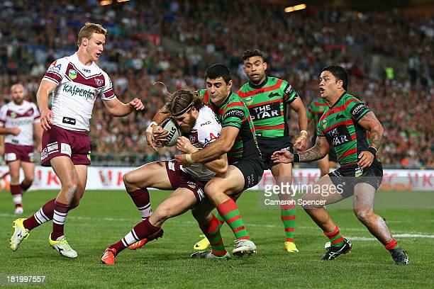 David Williams of the Sea Eagles is tackled during the NRL Preliminary Final match between the South Sydney Rabbitohs and the Manly Warringah Sea...