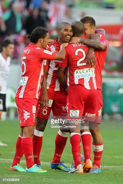 David Williams Patrick Gerhardt Patrick Kisnorbo and Nicholas Kalmar embrace following victory in the round 20 ALeague match between Melbourne Heart...