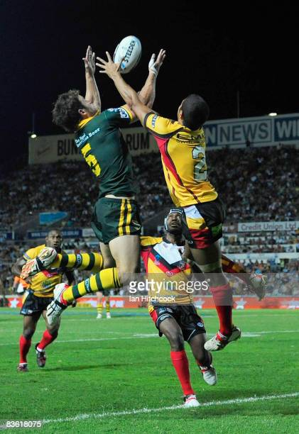 David Willliams of Australia contests a high ball with David Moore of PNG which lead to an Australian try during the 2008 Rugby League World Cup Pool...