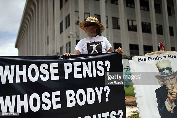 David Wilson joins with other protesters in front of the West Palm Beach federal courthouse where a judge will hear arguments in a case involving a...