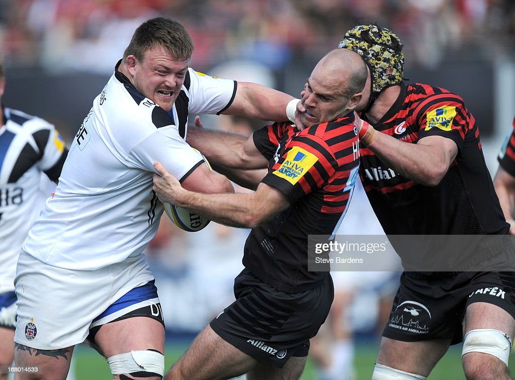 David Wilson of Bath hands off <a gi-track='captionPersonalityLinkClicked' href=/galleries/search?phrase=Charlie+Hodgson&family=editorial&specificpeople=202536 ng-click='$event.stopPropagation()'>Charlie Hodgson</a> of Saracens during the Aviva Premiership match between Saracens and Bath at Allianz Park on May 04, 2013 in Barnet, England.