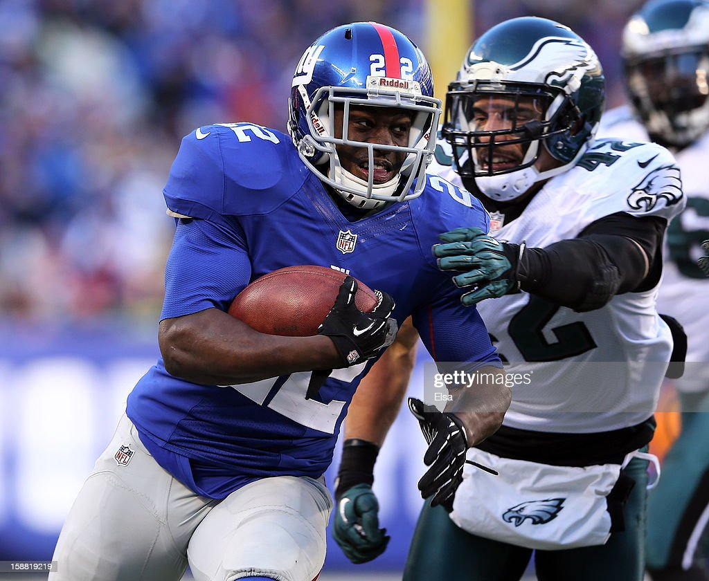 David Wilson #22 of the New York Giants carries the ball as Kurt Coleman #42 of the Philadelphia Eagles defends at MetLife Stadium on December 30, 2012 in East Rutherford, New Jersey. The New York Giants defeated the Philadelphia Eagles 42-7.