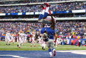 David Wilson of the New York Giants celebrates his touchdown against the Cleveland Browns by doing a backflip during their game at MetLife Stadium on...
