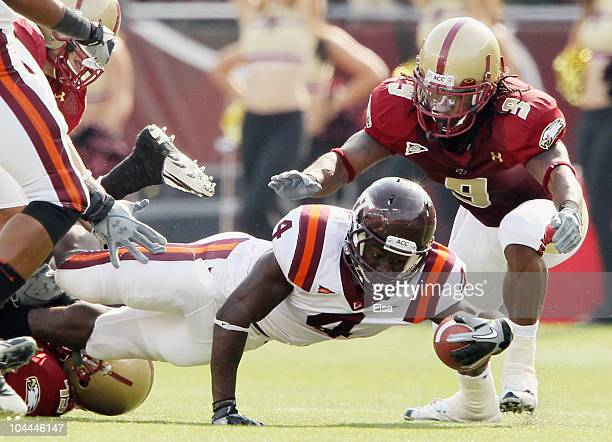 David Wilson of the Virginia Tech Hokies is tackled as DeLeon Gause of the Boston College Eagles defends on September 25 2010 at Alumni Stadium in...