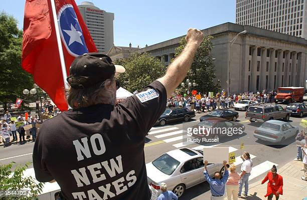 David Wilson protests with other antitax demonstrators against proposed legislation that would impose a Tennessee income tax May 22 2002 at the...