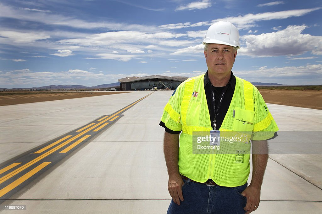 David Wilson, spokesperson for Spaceport America, stands in front of the taxiway at the Terminal Hangar Facility in Sierra County, New Mexico, U.S., on Thursday, July 14, 2011. The future home of Virgin Galactic is behind schedule and its director says it won't generate as many jobs as backers once claimed. Photographer: Christ Chavez/Bloomberg via Getty Images David Wilson