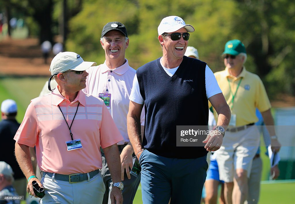 David Winkle of Cornerstone Sports (L) walks with hockey legend Wayne Gretzky during the first round of the 2014 Masters Tournament at Augusta National Golf Club on April 10, 2014 in Augusta, Georgia.