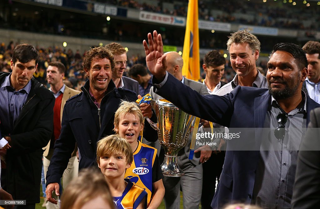 David Wirrpanda walks a lap of honour with team mates celebrating the West Coast Eagles 2006 Premiership anniversary during the round 15 AFL match between the West Coast Eagles and the Essendon Bombers at Domain Stadium on June 30, 2016 in Perth, Australia.