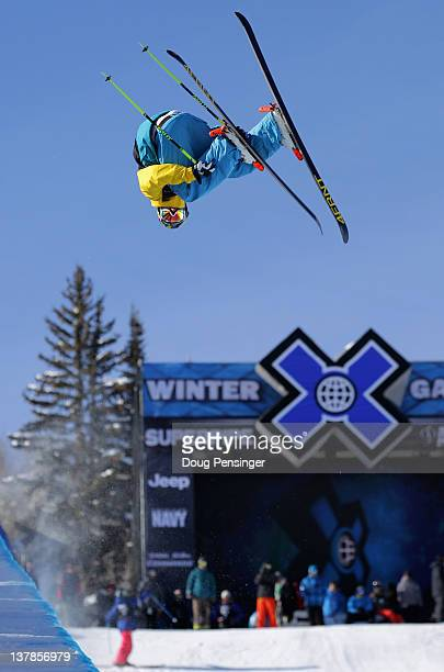 David Wise spins above the pipe as he warms up prior to the finals of the men's ski superpipe during Winter X Games 2012 at Buttermilk Mountain on...