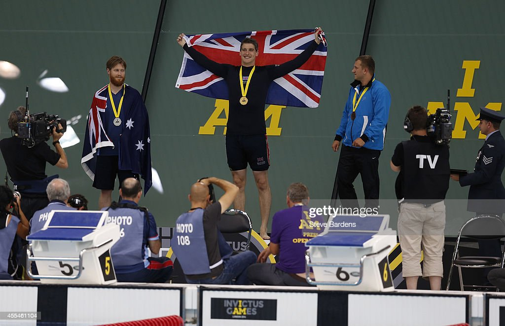 David Wiseman of Great Britain celebrates on the podium after his victory in the men's S14 100m freestyle swimming final at the London Aquatics Centre at Olympic Park on September 14, 2014 in London, England. Photo: