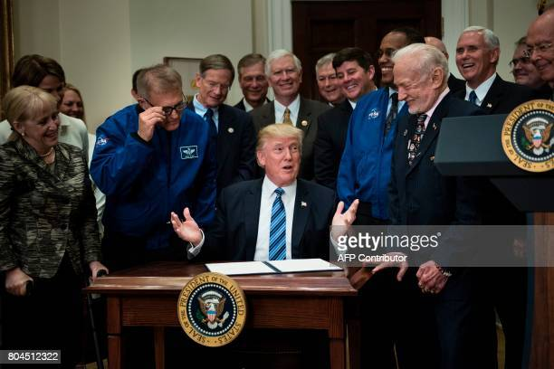 David Wolf former NASA astronaut and Buzz Aldrin former NASA astronaut and second man on the moon watch with others before US President Donald Trump...