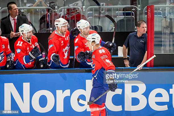 David Wolf of Adler celebrates with teammates during the Champions Hockey League match between Adler Mannheim and HC Lugano at SAP on August 18 2016...