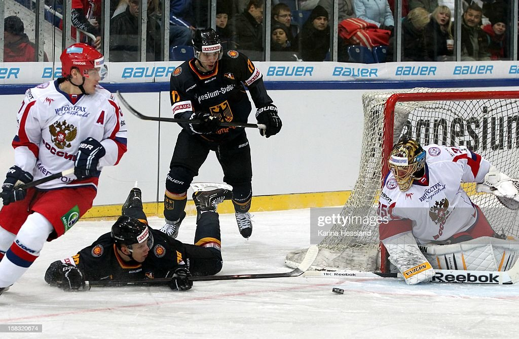 David Wolf of Germany challenges Goalkeeper Anton Khudobin of Russia during the Top Teams Sotchi match between Germany and Russia at Kuechwaldhalle on December 11, 2012 in Chemnitz, Germany.
