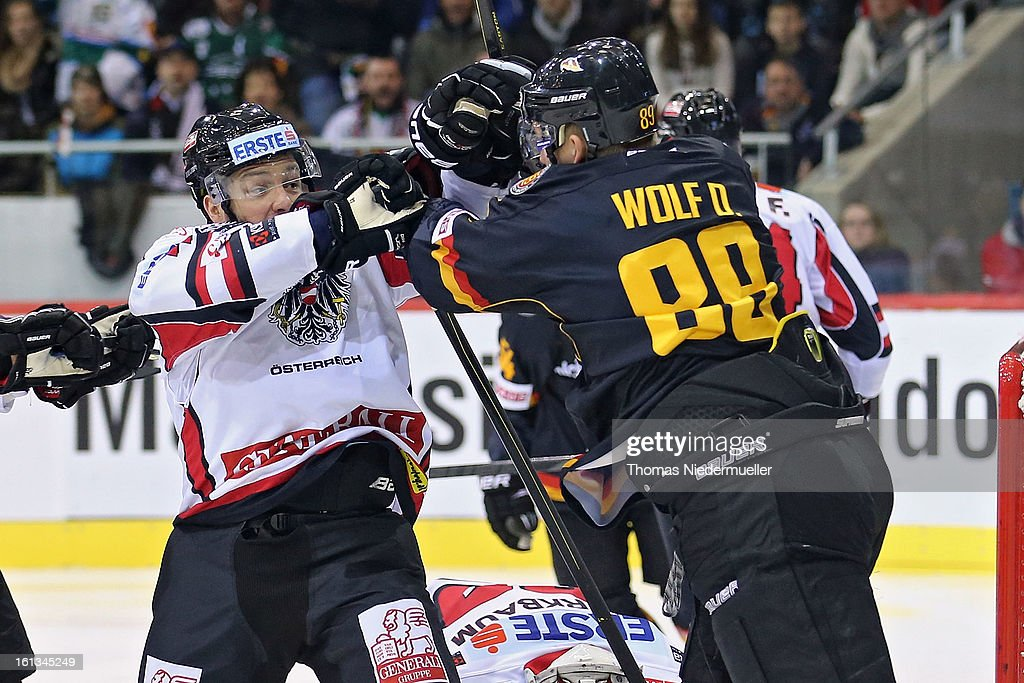 David Wolf (R) of Germany fights with Gerhard Unterluggauer (L) of Austria during the Olympic Icehockey Qualifier match between Germany and Austria on February 10, 2013 in Bietigheim-Bissingen, Germany.