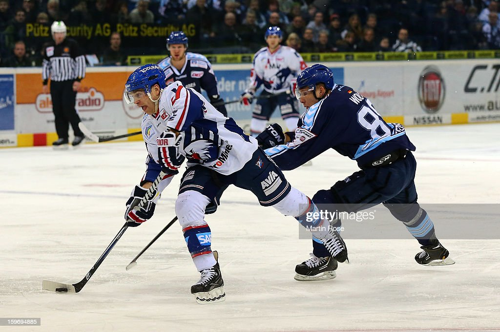 <a gi-track='captionPersonalityLinkClicked' href=/galleries/search?phrase=David+Wolf&family=editorial&specificpeople=90675 ng-click='$event.stopPropagation()'>David Wolf</a> (R) of Hamburg battles for the puck with Frank Mauer (R) of Mannheim during the DEL match between Hamburg Freezers and Adler Mannheim at O2 World on January 18, 2013 in Hamburg, Germany.