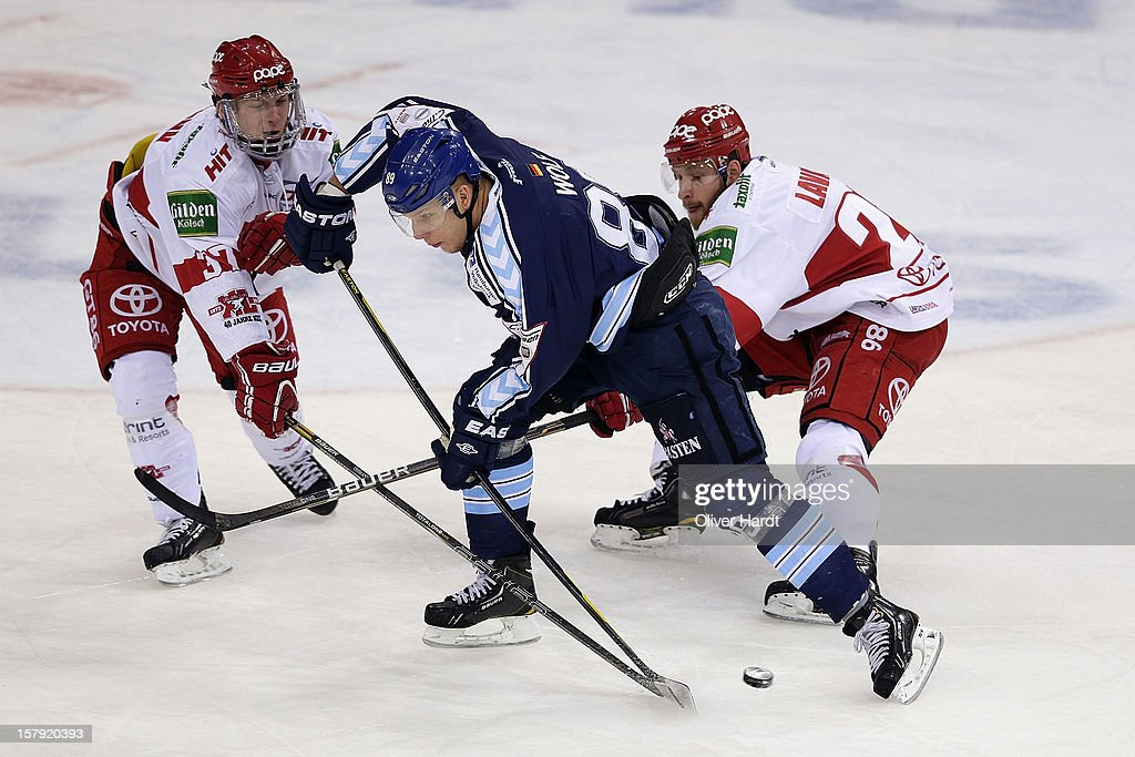 <a gi-track='captionPersonalityLinkClicked' href=/galleries/search?phrase=David+Wolf&family=editorial&specificpeople=90675 ng-click='$event.stopPropagation()'>David Wolf</a> (C) of Hamburg battles for the puck with Kevin Lavallee (R) of Cologne during the DEL 1 Bundesliga match between Hamburg and Cologne at O2 World on December 7, 2012 in Hamburg, Germany.