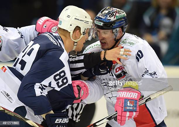 David Wolf of the Hamburg Freezers and Spencer Machacek of the Eisbaeren Berlin argue during the game between Hamburg Freezers and Eisbaeren Berlin...