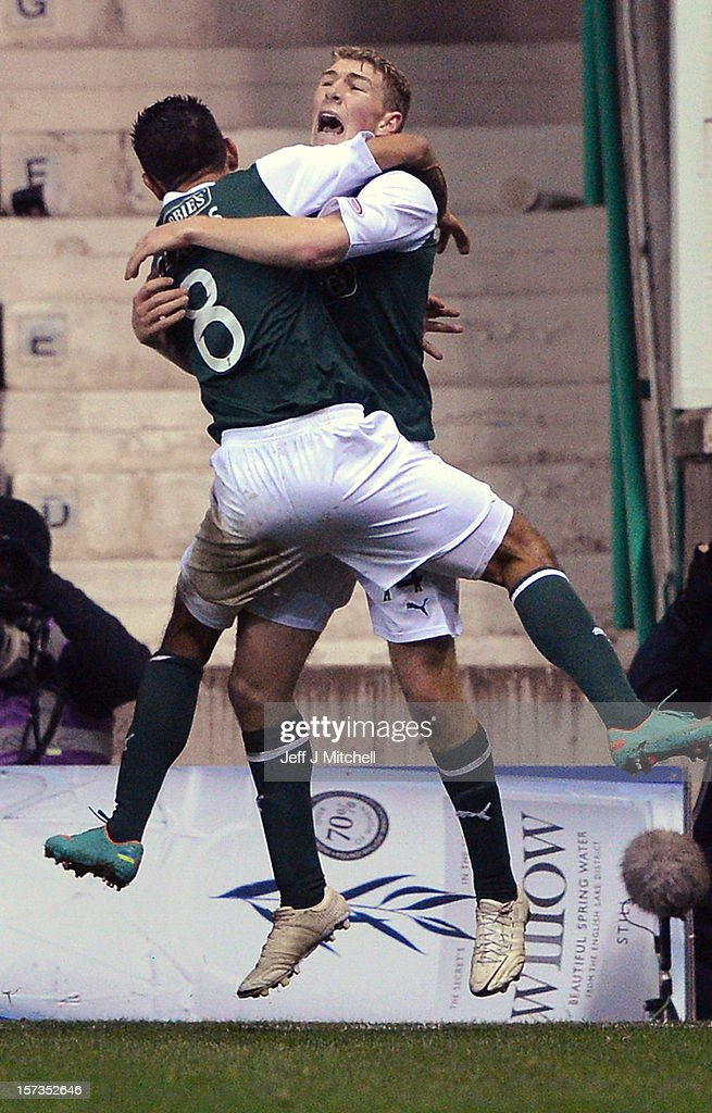 David Wotherspoon of Hibernian celebrates with Jorge Carlos after scoring during the Scottish Cup match between Hibernian and Hearts at Easter Road Stadium on December 2, 2012 in Edinburgh,Scotland.