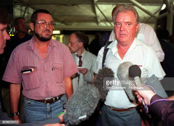 David Wright 52 and Charlie Nolan 66 are greeted by the media on their arrival at Stansted airport in the early hours of this morning having fled...