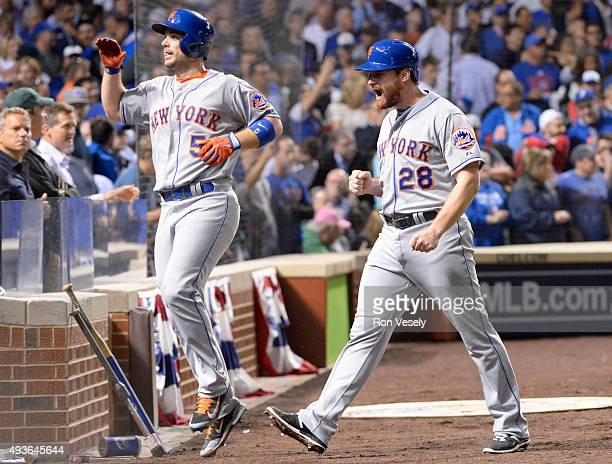 David Wright and Daniel Murphy of the New York Mets celebrate after scoring on Lucas Duda's twoRBI double in the second inning of Game 4 of the NLCS...