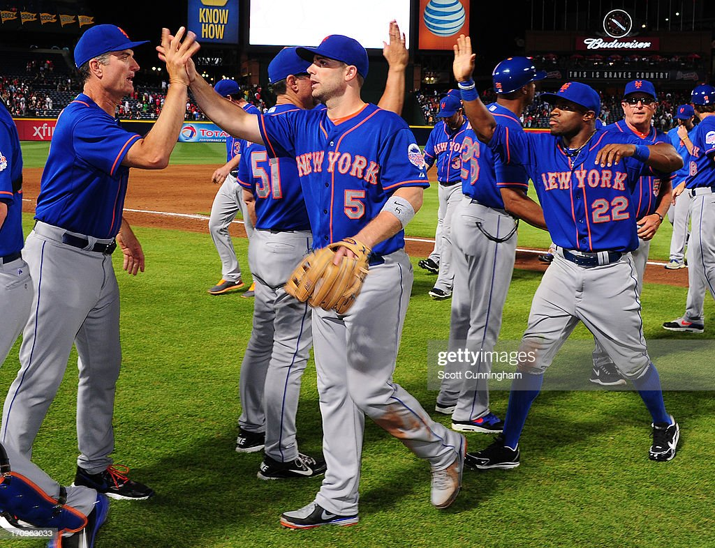 <a gi-track='captionPersonalityLinkClicked' href=/galleries/search?phrase=David+Wright+-+Baseball+Player&family=editorial&specificpeople=209172 ng-click='$event.stopPropagation()'>David Wright</a> #5 and Eric Young #22 of the New York Mets celebrate after the game against the Atlanta Braves at Turner Field on June 20, 2013 in Atlanta, Georgia.