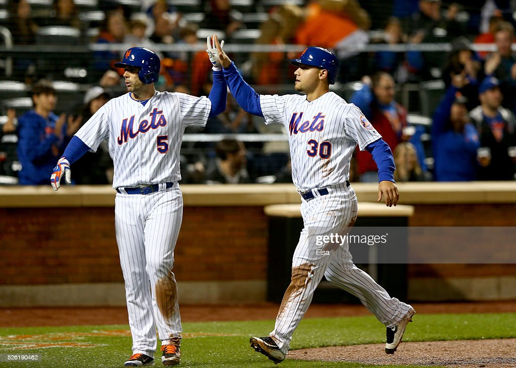 <a gi-track='captionPersonalityLinkClicked' href=/galleries/search?phrase=David+Wright+-+Baseball+Player&family=editorial&specificpeople=209172 ng-click='$event.stopPropagation()'>David Wright</a> #5 and <a gi-track='captionPersonalityLinkClicked' href=/galleries/search?phrase=Michael+Conforto&family=editorial&specificpeople=14076889 ng-click='$event.stopPropagation()'>Michael Conforto</a> #30 of the New York Mets score off a hit by teammate Yoenis Cespedes in the third inning against the San Francisco Giants at Citi Field on April 29, 2016 in the Flushing neighborhood of the Queens borough of New York City.