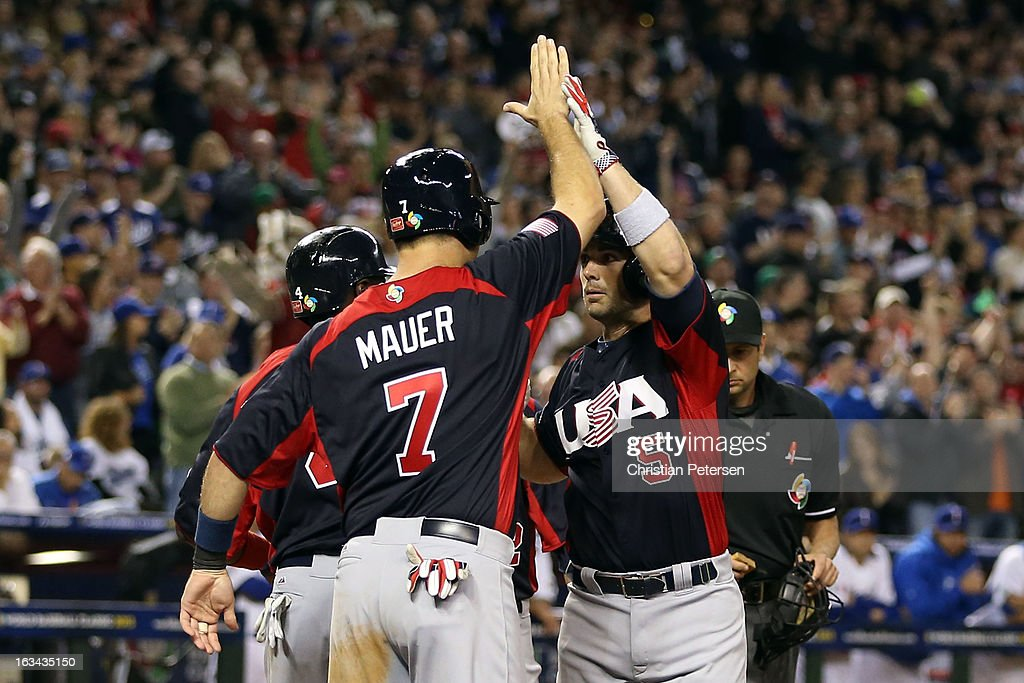 David Wright #5 of Team USA celebrates with his teammates Joe Mauer #7 and Brandon Phillips #4 after hitting a Grand Slam in the fifth inning against Matt Torra #43 of Team Italy during the World Baseball Classic First Round Group D game at Chase Field on March 9, 2013 in Phoenix, Arizona.