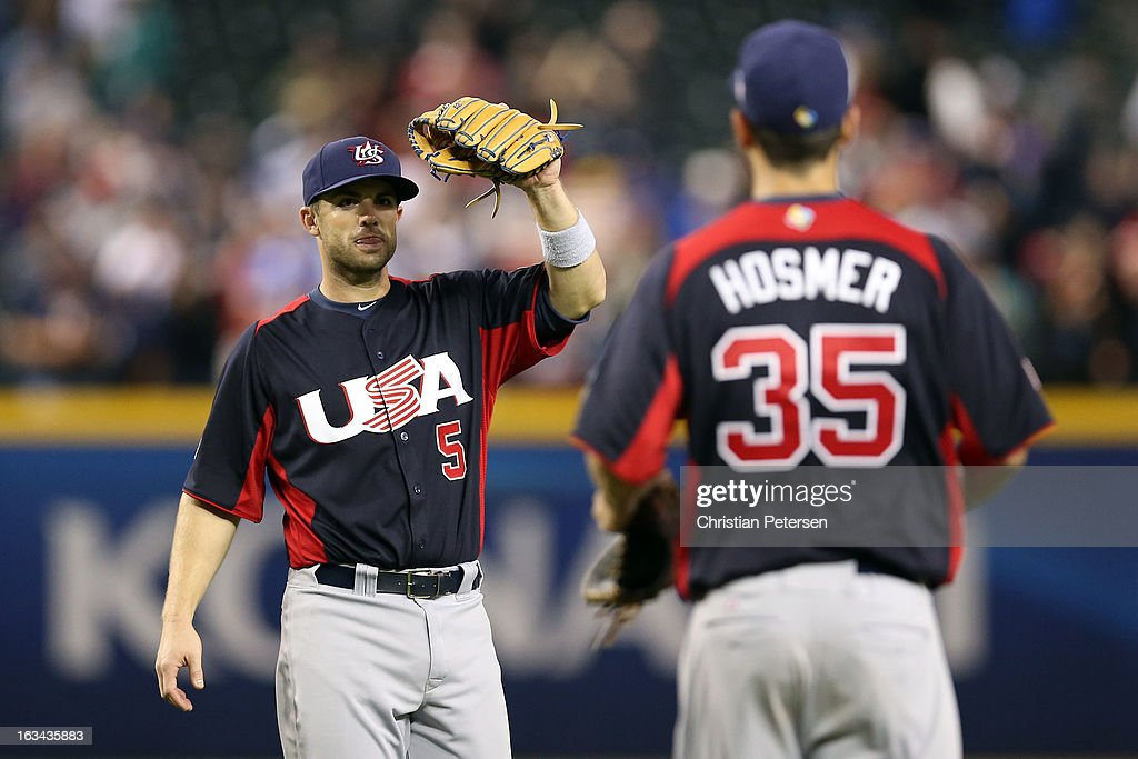 David Wright #5 of Team USA celebrates with teammate Eric Hosmer #35 after defeating Team Italy 6 to 2 after the World Baseball Classic First Round Group D game against team Italy at Chase Field on March 9, 2013 in Phoenix, Arizona.