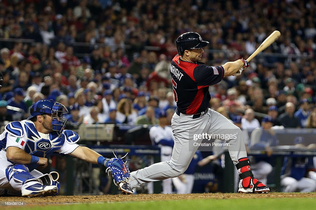David Wright #5 of Team USA hits a Grand Slam in the fifth inning against Matt Torra #43 of Italy during the World Baseball Classic First Round Group D game at Chase Field on March 9, 2013 in Phoenix, Arizona.