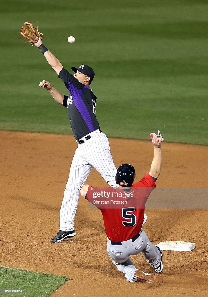 <a gi-track='captionPersonalityLinkClicked' href=/galleries/search?phrase=David+Wright+-+Baseball+Player&family=editorial&specificpeople=209172 ng-click='$event.stopPropagation()'>David Wright</a> #5 of Team USA slides into second base as infielder <a gi-track='captionPersonalityLinkClicked' href=/galleries/search?phrase=Reid+Brignac&family=editorial&specificpeople=4175431 ng-click='$event.stopPropagation()'>Reid Brignac</a> #16 of the Colorado Rockies attempts to catch the ball during the spring training game at Salt River Fields at Talking Stick on March 6, 2013 in Scottsdale, Arizona.