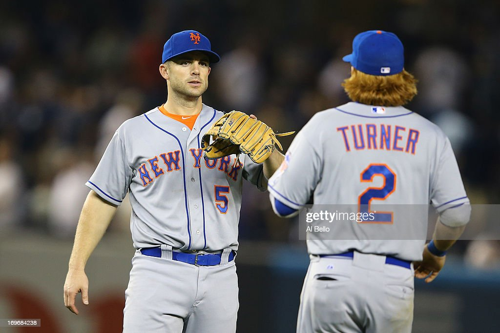 <a gi-track='captionPersonalityLinkClicked' href=/galleries/search?phrase=David+Wright+-+Baseball+Player&family=editorial&specificpeople=209172 ng-click='$event.stopPropagation()'>David Wright</a> #5 of the New York Mets and <a gi-track='captionPersonalityLinkClicked' href=/galleries/search?phrase=Justin+Turner&family=editorial&specificpeople=550296 ng-click='$event.stopPropagation()'>Justin Turner</a> #2 of the New York Mets celebrate a 3-1 win against the New York Yankees during their game on May 30, 2013 at Yankee Stadium in the Bronx borough of New York City