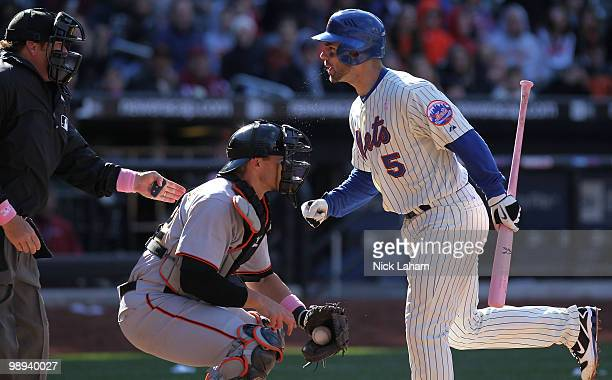 David Wright of the New York Mets argues with home plate umpire Paul Schrieber after striking out in the ninth inning against the San Francisco...