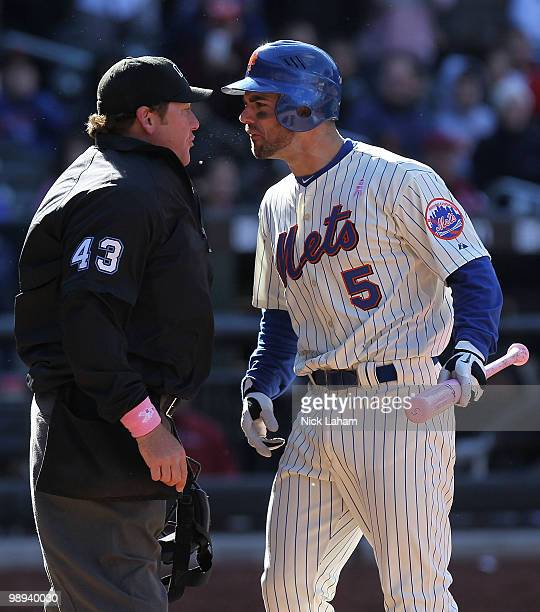 David Wright of the New York Mets argues with home plate umpire Paul Schrieber after being thrown out of the game in the ninth inning against the San...