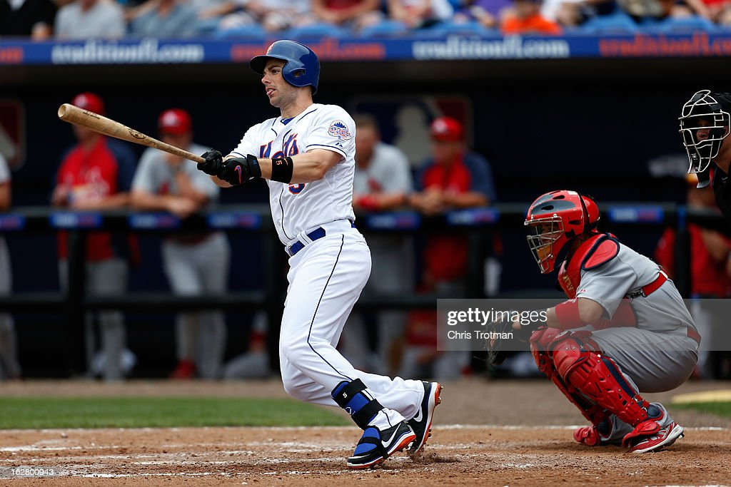 <a gi-track='captionPersonalityLinkClicked' href=/galleries/search?phrase=David+Wright+-+Baseball+Player&family=editorial&specificpeople=209172 ng-click='$event.stopPropagation()'>David Wright</a> #5 of the New York Mets at bat as <a gi-track='captionPersonalityLinkClicked' href=/galleries/search?phrase=Yadier+Molina&family=editorial&specificpeople=172002 ng-click='$event.stopPropagation()'>Yadier Molina</a> #4 of the St. Louis Cardinals looks on at Tradition Field on February 27, 2013 in Port St. Lucie, Florida.
