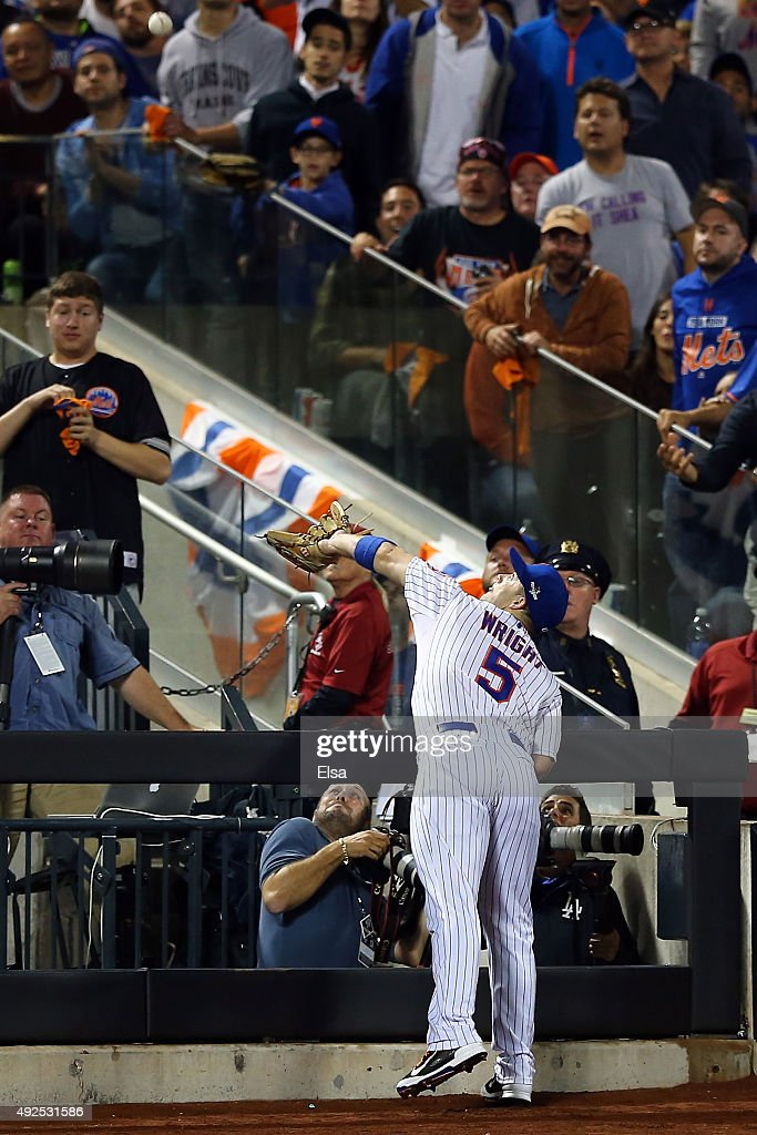 David Wright #5 of the New York Mets catches a foul ball hit by Corey Seager #5 of the Los Angeles Dodgers in the eighth inning during game four of the National League Division Series at Citi Field on October 13, 2015 in New York City.