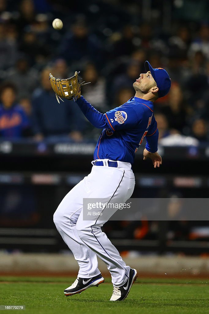 <a gi-track='captionPersonalityLinkClicked' href=/galleries/search?phrase=David+Wright+-+Baseball+Player&family=editorial&specificpeople=209172 ng-click='$event.stopPropagation()'>David Wright</a> #5 of the New York Mets catches a popup hit by Donovan Solano #17 of the Miami Marlins during their game on April 5, 2013 at Citi Field in the Flushing neighborhood of the Queens borough of New York City.