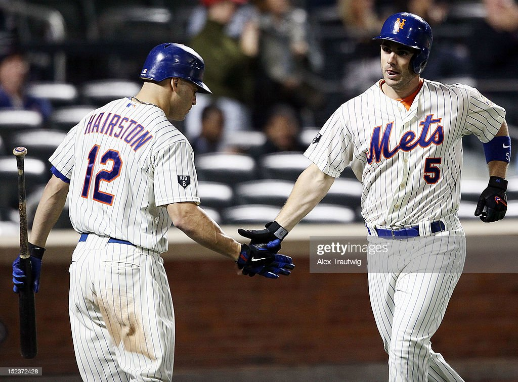 <a gi-track='captionPersonalityLinkClicked' href=/galleries/search?phrase=David+Wright+-+Baseball+Player&family=editorial&specificpeople=209172 ng-click='$event.stopPropagation()'>David Wright</a> #5 of the New York Mets celebrates a home run in the sixth inning against the Philadelphia Phillies with teammate <a gi-track='captionPersonalityLinkClicked' href=/galleries/search?phrase=Scott+Hairston&family=editorial&specificpeople=836506 ng-click='$event.stopPropagation()'>Scott Hairston</a> at Citi Field on September 19, 2012 in the Flushing neighborhood of the Queens borough of New York City.
