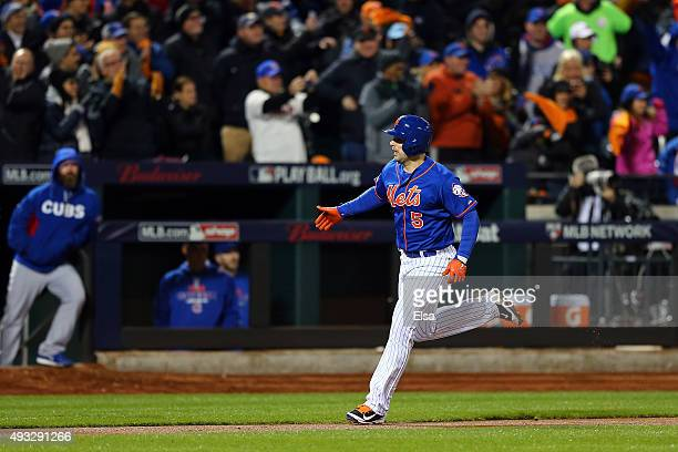 David Wright of the New York Mets celebrates after scoring off of Daniel Murphy's two run home run in the first inning against Jake Arrieta of the...