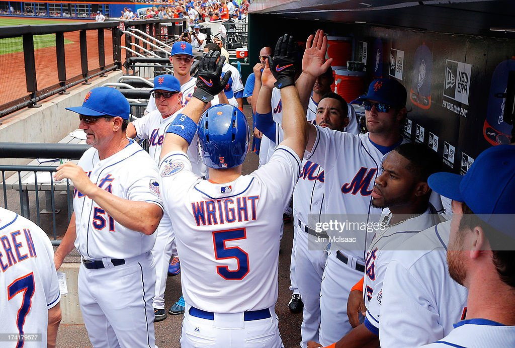 <a gi-track='captionPersonalityLinkClicked' href=/galleries/search?phrase=David+Wright+-+Baseball+Player&family=editorial&specificpeople=209172 ng-click='$event.stopPropagation()'>David Wright</a> #5 of the New York Mets celebrates his first inning home run against the Philadelphia Phillies at Citi Field on July 21, 2013 in the Flushing neighborhood of the Queens borough of New York City.