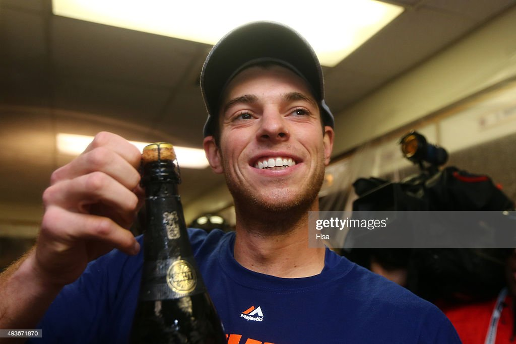 David Wright #5 of the New York Mets celebrates in the locker room with his teammates after defeating the Chicago Cubs in game four of the 2015 MLB National League Championship Series at Wrigley Field on October 21, 2015 in Chicago, Illinois. The Mets defeated the Cubs with a score of 8 to 3 to sweep the Championship Series.