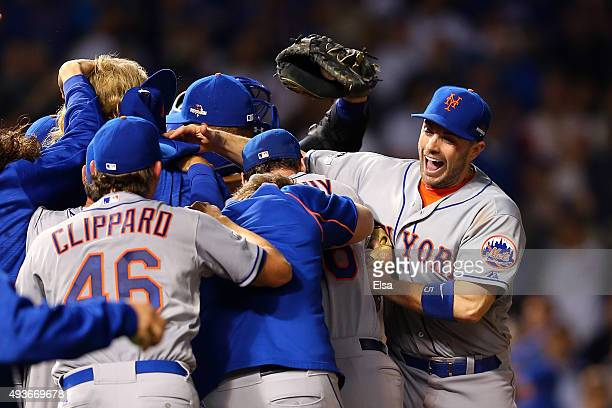 David Wright of the New York Mets celebrates with his teammates after defeating the Chicago Cubs in game four of the 2015 MLB National League...