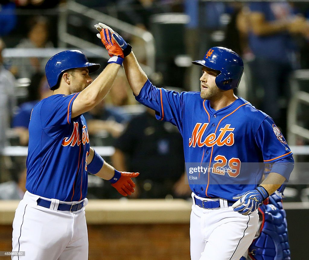 <a gi-track='captionPersonalityLinkClicked' href=/galleries/search?phrase=David+Wright+-+Baseball+Player&family=editorial&specificpeople=209172 ng-click='$event.stopPropagation()'>David Wright</a> #5 of the New York Mets celebrates with teammate <a gi-track='captionPersonalityLinkClicked' href=/galleries/search?phrase=Eric+Campbell&family=editorial&specificpeople=90797 ng-click='$event.stopPropagation()'>Eric Campbell</a> #29 after Campbell hit a three run home run in the fourth inning against the Chicago Cubs on August 15, 2014 at Citi Field in the Flushing neighborhood of the Queens borough of New York City.