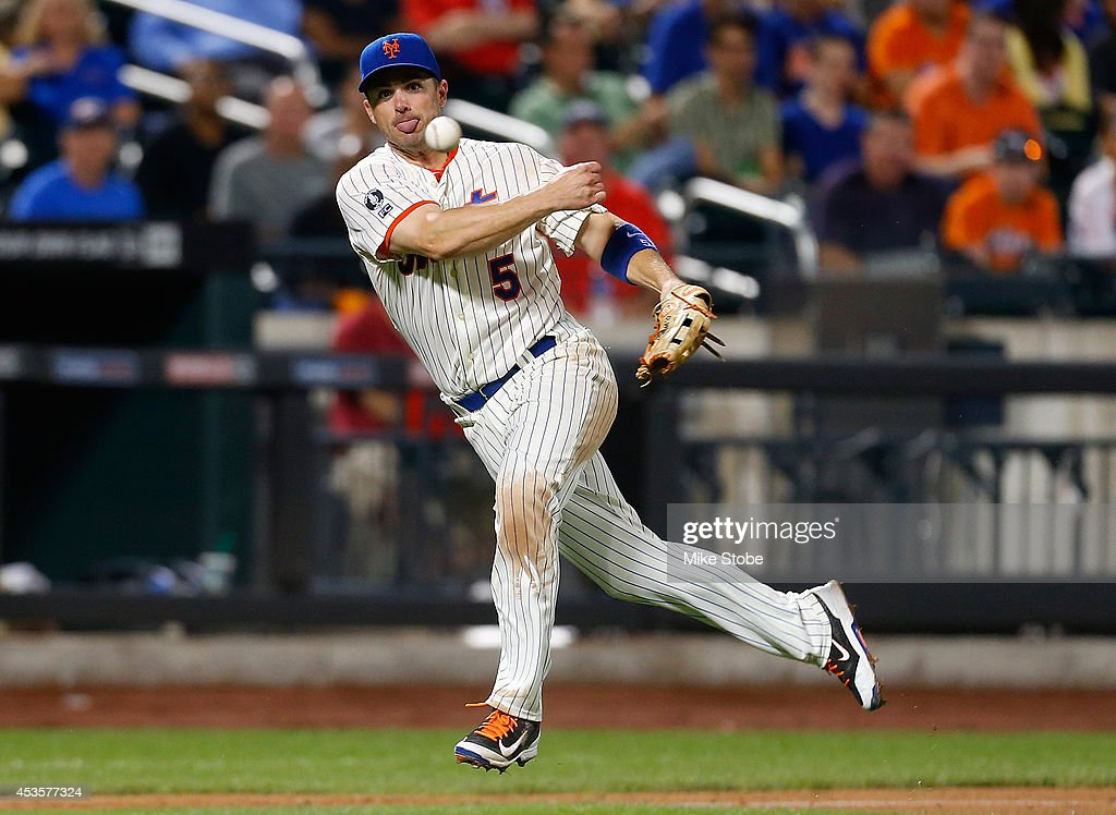 <a gi-track='captionPersonalityLinkClicked' href=/galleries/search?phrase=David+Wright+-+Baseball+Player&family=editorial&specificpeople=209172 ng-click='$event.stopPropagation()'>David Wright</a> #5 of the New York Mets field the ball for an out in the seventh inning against the Washington Nationals at Citi Field on August 13, 2014 in the Flushing neighborhood of the Queens borough of New York City.