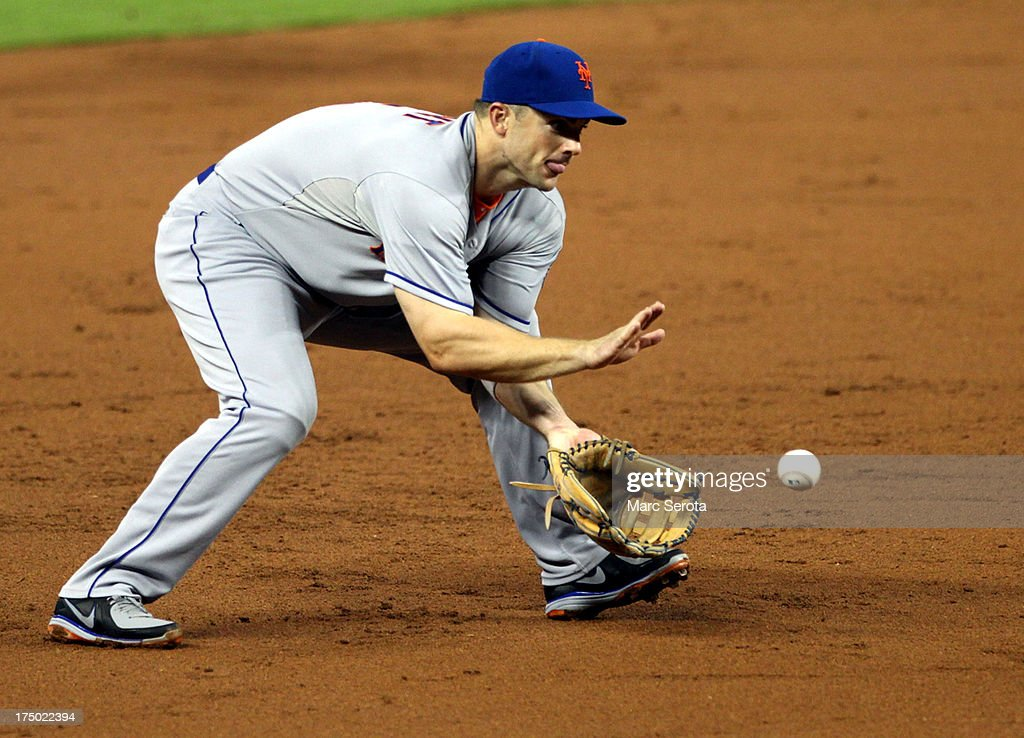 <a gi-track='captionPersonalityLinkClicked' href=/galleries/search?phrase=David+Wright+-+Baseball+Player&family=editorial&specificpeople=209172 ng-click='$event.stopPropagation()'>David Wright</a> #5 of the New York Mets fields a ground ball against the Miami Marlins at Marlins Park on July 29, 2013 in Miami, Florida. The Mets defeated the Marlins 6-5.