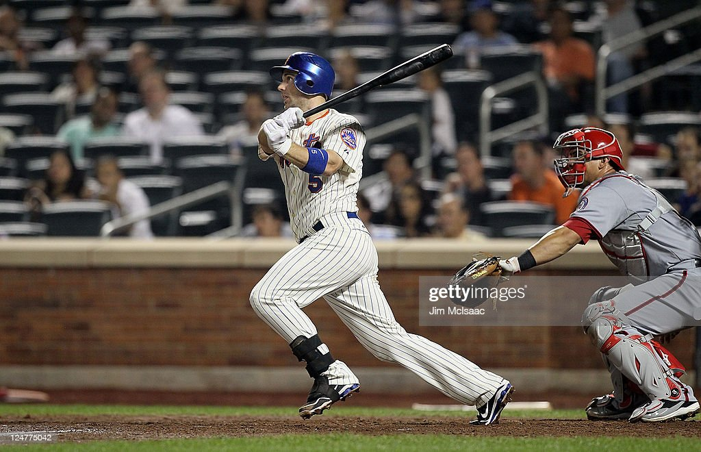 <a gi-track='captionPersonalityLinkClicked' href=/galleries/search?phrase=David+Wright+-+Baseball+Player&family=editorial&specificpeople=209172 ng-click='$event.stopPropagation()'>David Wright</a> #5 of the New York Mets follows through on his sixth inning RBI single against the Washington Nationals at Citi Field on September 12, 2011 in the Flushing neighborhood of the Queens borough of New York City.