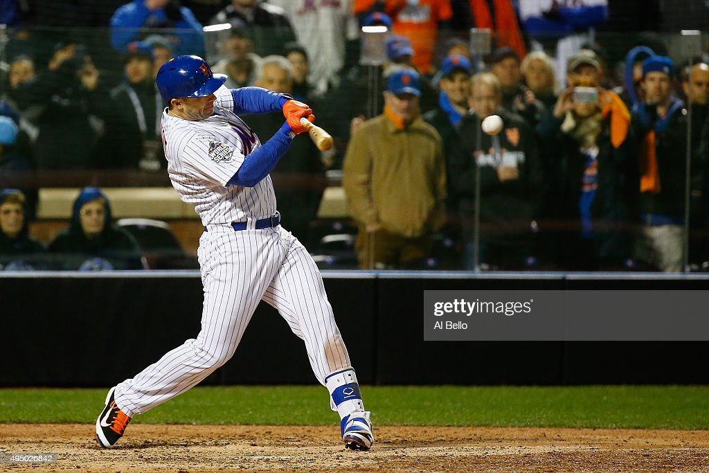 David Wright #5 of the New York Mets hits an RBI single in the sixth inning against the Kansas City Royals during Game Three of the 2015 World Series at Citi Field on October 30, 2015 in the Flushing neighborhood of the Queens borough of New York City.